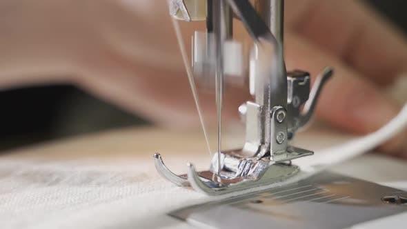 Woman Sews on a Sewing Machine Closeup of a Moving Needle Closeup