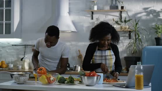 Cover Image for Couple Preparing Food Together in the Kitchen