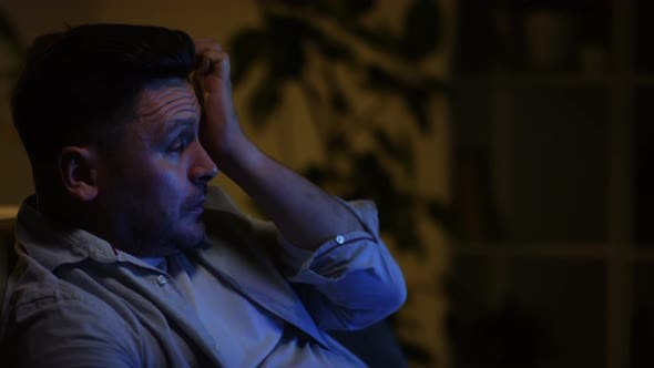 Thumbnail for Man Crying During Movie in Dark Room