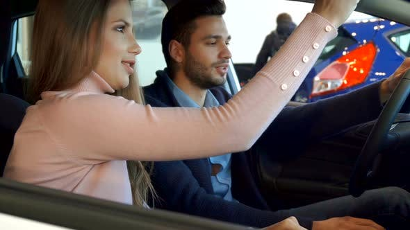 Thumbnail for Man Points His Hand on the Console of the Car