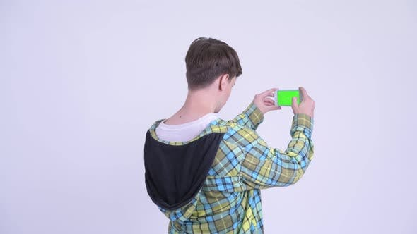 Cover Image for Rear View of Young Man Taking Picture with Phone