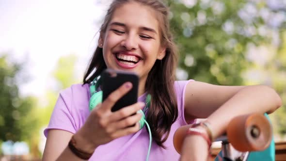 Thumbnail for Happy Teenage Girl with Smartphone and Longboard