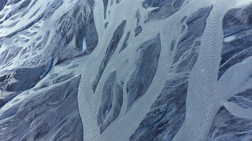 Flying Over a Large Icelandic Glacial River System and Black Volcanic Sediments, Iceland