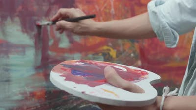 Hand Holding Paint Brush And Painting Art