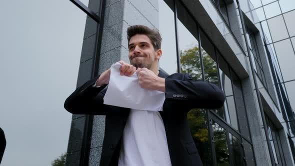 Thumbnail for Serious businessman tearing contract in pieces.Furious male office worker throwing crumpled paper