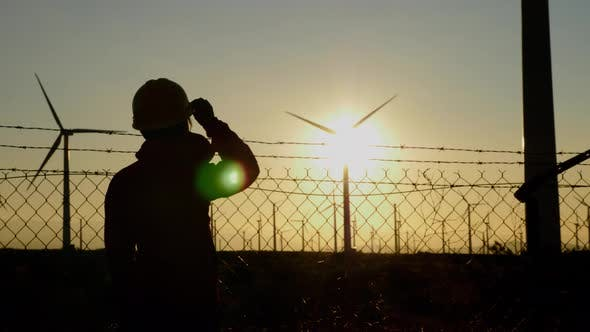 Thumbnail for Woman engineer inspecting a wind farm in California
