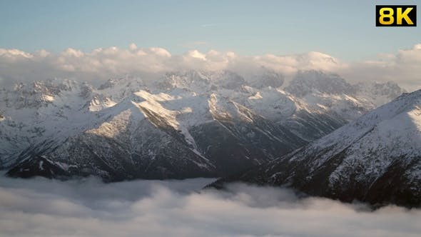 Thumbnail for Snowy Mountains and Valleys Above the Clouds