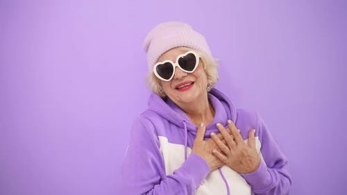 Stylish Mature Woman in Modern Glasses Sends Love To Everyone, Gesturing with Her Hands, Flirting