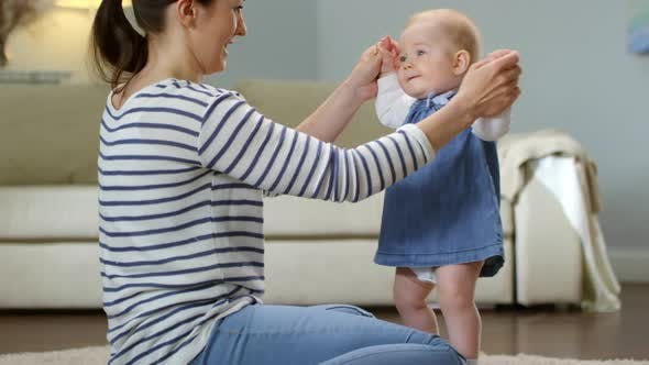 Cover Image for Baby Making Dancing Moves with Mother