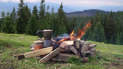 Bonfire and Coffee Maker in the Mountains
