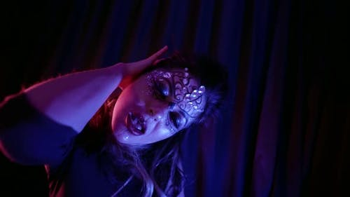 Erotic Dance Performer Woman Is Moving Slowly and Seductively in Darkness