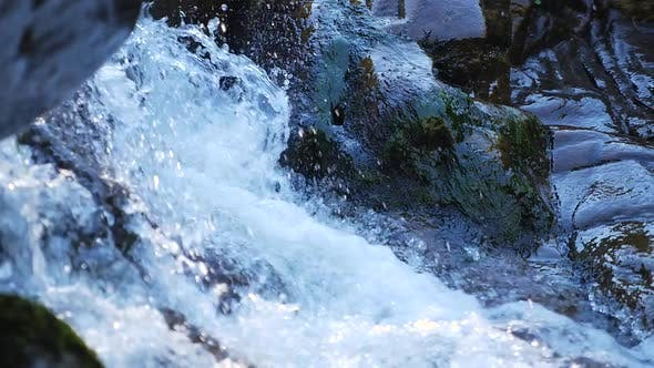 Thumbnail for Showing Water Rush Down Small Rapids Into Stream 2