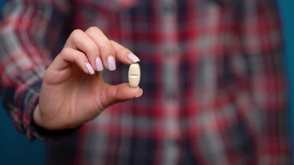 Woman Presenting a Hand Pills