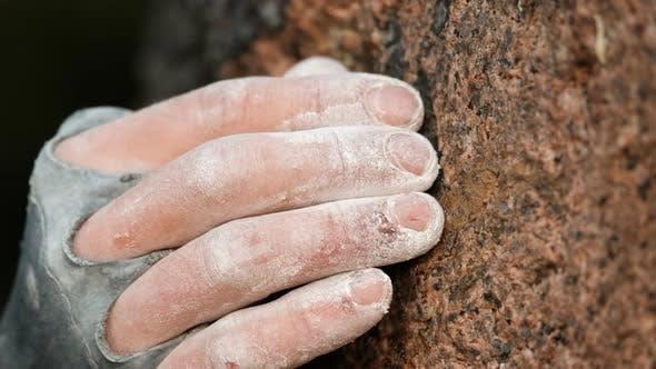 Super Close  Up of a Climber's Fingers Grabbing a Crimper