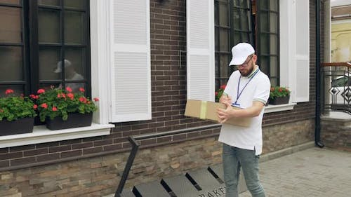 Courier with Badge Delivering Parcel