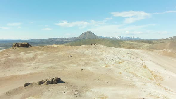 Thumbnail for Raven Flies Over Hverir Geothermal Area. Iceland. Aerial View