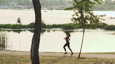 Side View Young Fitness Woman Jogging Outdoor