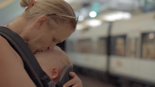 Thumbnail for Mum with Sleeping Child in Baby Carrier Waiting for Subway Train