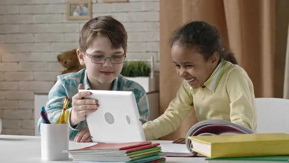 Cover Image for Cute Kids Using Tablet