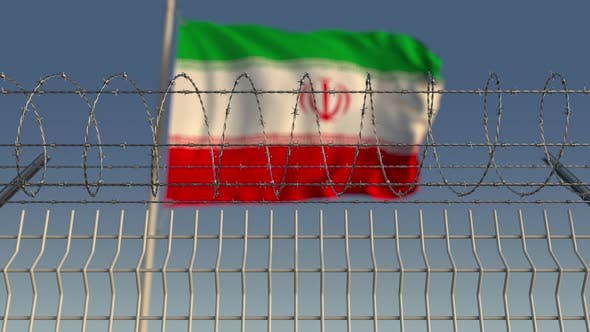 Thumbnail for Blurred Waving Flag of Iran Behind Barbed Wire Fence