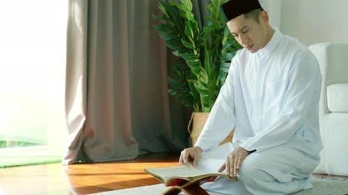 Asian Muslim Man Reading the Qur'an