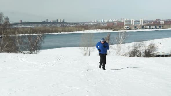 Thumbnail for Man Running Up The Hill In Winter