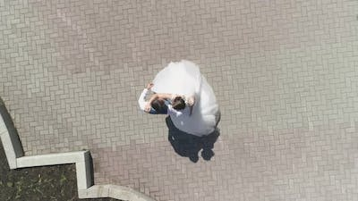 Aerial view of wedding couple dancing in a park 22