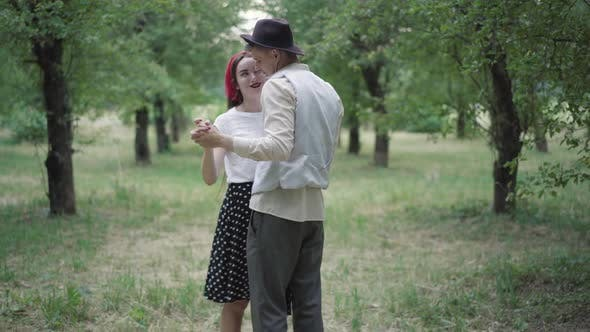 Thumbnail for Slow Dance of Happy Elegant Young Couple in Summer Park. Smiling Loving Man and Woman Dancing