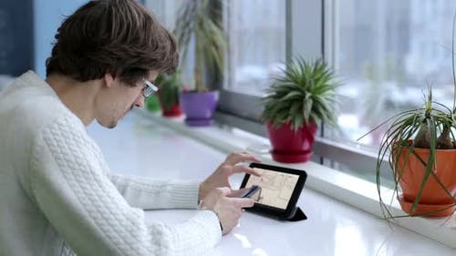 Engineer designer works with drawings on a tablet in the office.