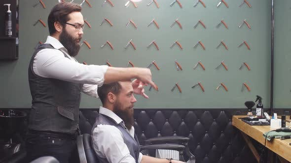 Thumbnail for Skillful Barber. Young Man Getting an Old-fashioned Shave with Straight Razor