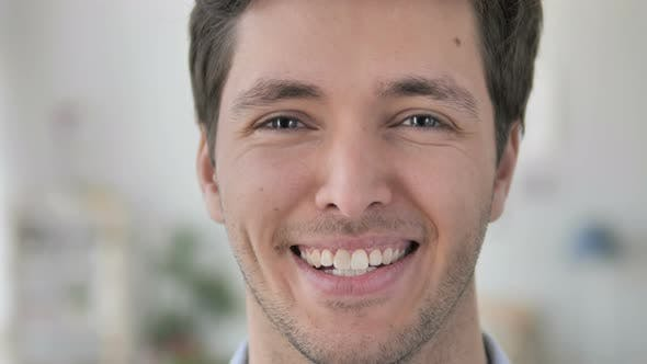 Thumbnail for Face Close Up of Smiling Handsome Young Man