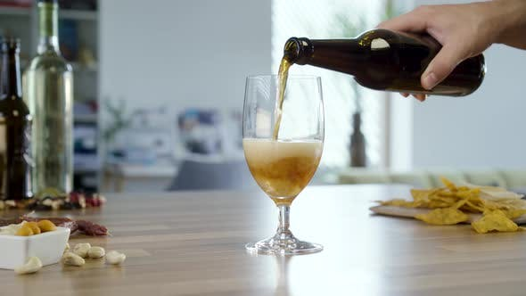 Pouring Dark Beer In To Glass