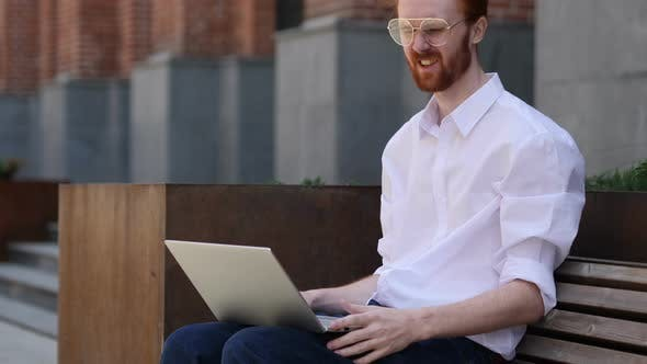 Thumbnail for Loss, Man Frustrated by Results on Laptop while Sitting on bench