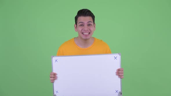 Thumbnail for Happy Young Multi Ethnic Man Holding White Board and Looking Surprised