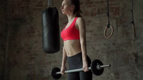 Athlete Female Doing Deadlift Exercise Weight Lifting Workout at Gym