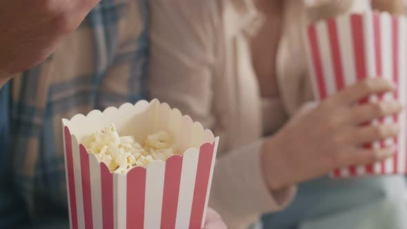 Thumbnail for Unrecognizable People Holding Popcorn Boxes