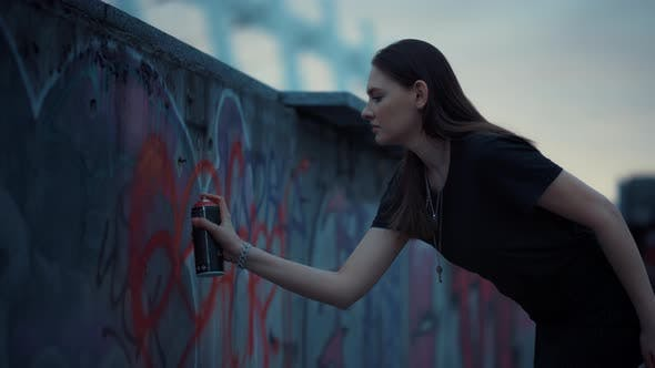 Thumbnail for Girl Drawing Graffiti with Spray Paint on Wall. Woman Using Aerosol Paint