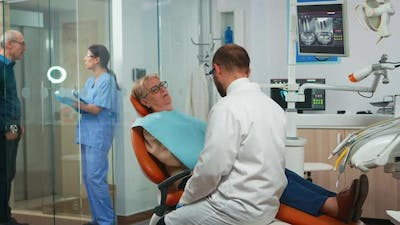 Orthodontist Speaking to Patient with Toothache