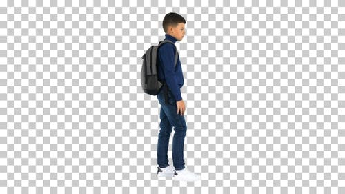 Boy in polo neck standing with a backpack, Alpha Channel