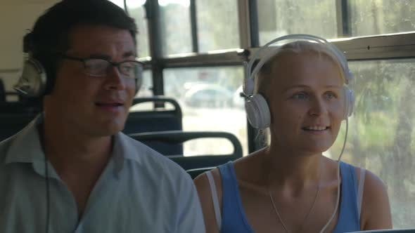 Cover Image for Young Couple Listening To Music on Headphones During the Bus Ride, They Dance To the Music, Man