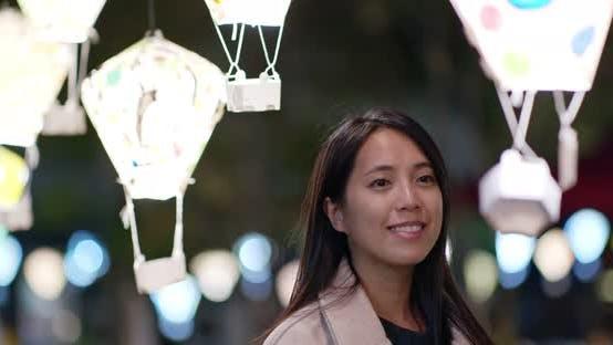 Thumbnail for Woman look at the beautiful lantern at night