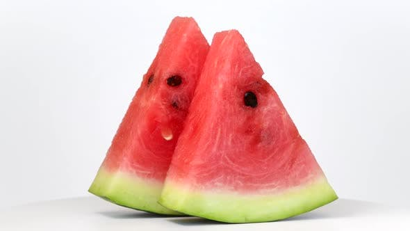 Thumbnail for Watermelon slices rotating on white background