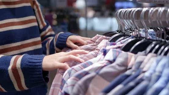 Thumbnail for Woman shopping for clothes fashion designer browsing wardrobe