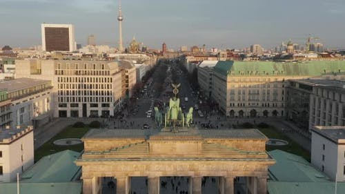AERIAL: Slowly Approaching Brandenburg Gate and Tiergarten in Beautiful Sunset Sunlight with Close