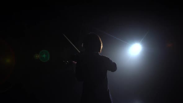 Thumbnail for Girl Standing Back and Playing on Violins in a Dark Room