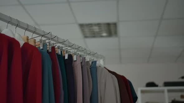 Assorted Clothes on Rail in Shop
