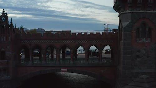Slow Follow Shot Person Walking Through Bridge Tunnel Berlin Oberbaum Bridge Medium Aerial Tracking