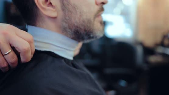Grayhaired Man in a Barber Shop
