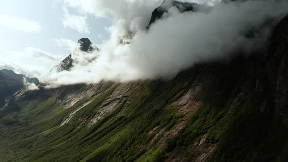 Thumbnail for Mountains in the Clouds Near Trollstigen. Rauma Municipality in Norway.