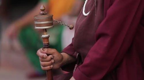 Buddhist monk spinning a prayer wheel in Kathmandu, Nepal.